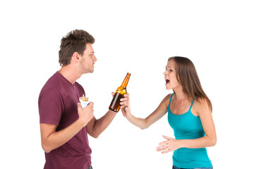 Drunk man gives alcohol to girl.