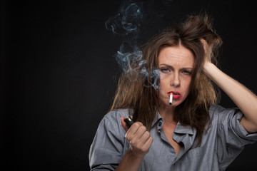 Portrait of exhausted female holding cigarette.