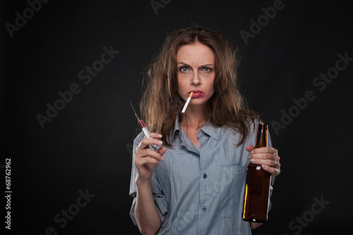 portrait of woman smoking cigarette hanging out of her mouth