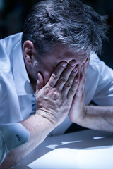 Distraught man in the office