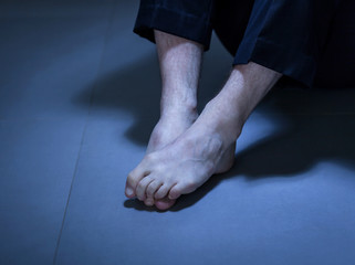 Close-up of depressed man's feet