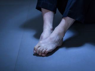 Close-up of depressed man's feet