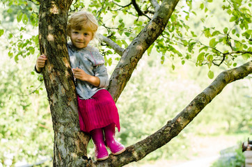 blond girl on tree
