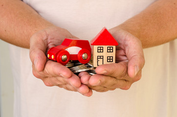 house and car in hands