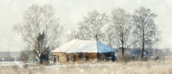 Winter in the village, wooden house