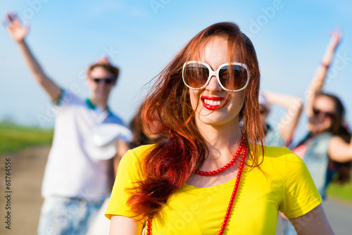 stylish young woman in sunglasses