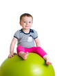 Child having fun with fitball isolated