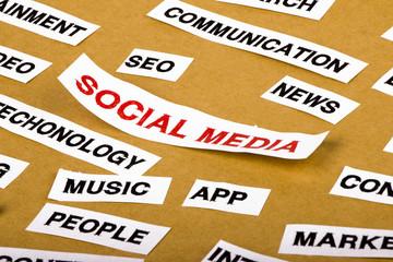 social media concept on torn paper