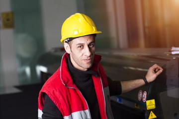 Machine operator working at factory