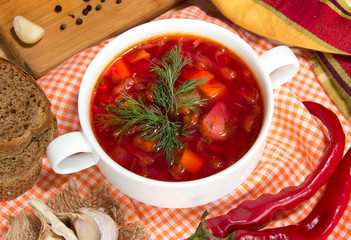 Borsch in white bowl. Red beetroot ukrainianl soup closeup.