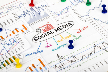 social media concept with financial and marketing charts