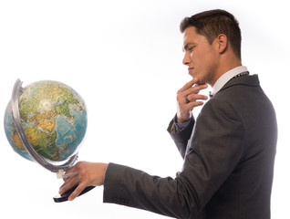 Young man holding a desktop globe