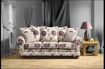 floral sofa in black and white room on wooden floor