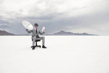 Businessman Holding Satellite Communication Tablet