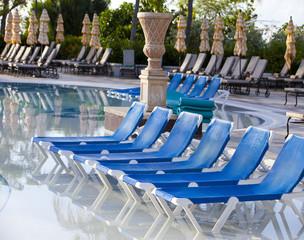 Empty beach chair before pool