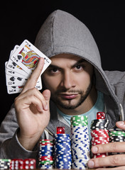 Mystic poker player holding royal flush