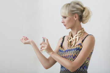 Young woman with perfume
