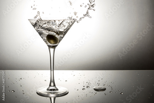 Olive splashing on martini - 68770141