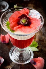 Flaky fruit jelly in glasses decorated with poppies