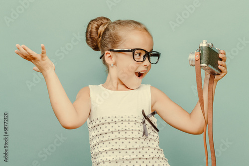 smiling child  holding a  camera Poster