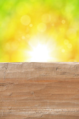 Empty rustic wooden table with abstract summer background