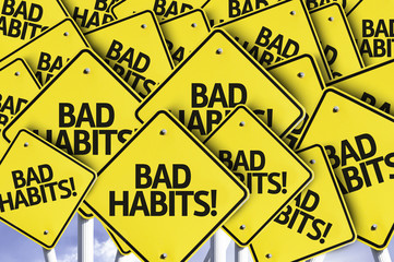 Bad Habits! written on multiple road sign