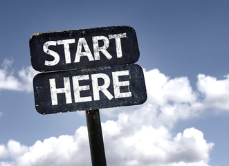 Start Here sign with clouds and sky background