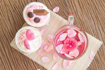 Rose tea  and sweet cupcake on table in the garden,Beautiful tea