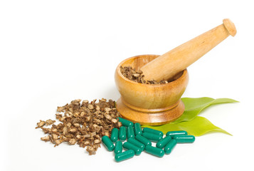 Mortar and pestle with herb capsules
