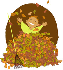 Little boy playing in a pile of fallen leaves