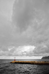Red lighthouse with black and white background
