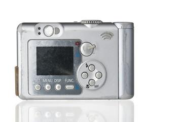 Grunge compact photo camera on white backdrop