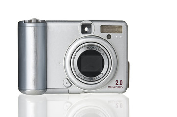 Old-fashioned dirty compact photo camera on white background
