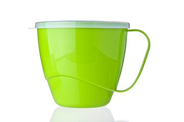 Green plastic cup on white background
