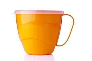 Yellow plastic cup on white background