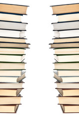 Stacks of books on white background