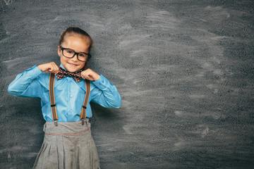 girl against chalkboard
