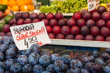 Plums on the market stand in Poland.