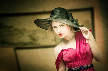 Charming blonde woman with black hat, retro image