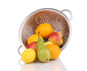 Metal colander full of juicy fruits.