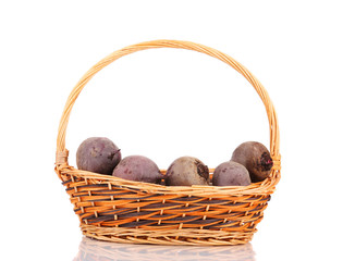 Wicker basket full of ripe beetroots.