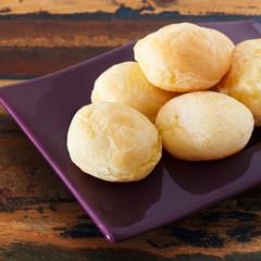 Brazilian snack cheese bread (pao de queijo) on purple plate