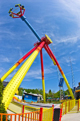 Wide view of a colorful swings in Prater amusement park, Vienna
