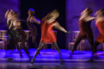 Group of contemporary dancers performing on stage