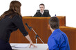 defendant with lawyer speaking to a judge in the courtroom - 68779150