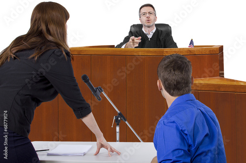 defendant with lawyer speaking to a judge in the courtroom - 68779174