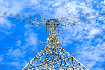 electricity high voltage power pylon against blue sky