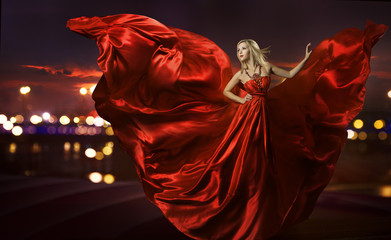 woman dancing in silk dress, artistic red blowing gown waving