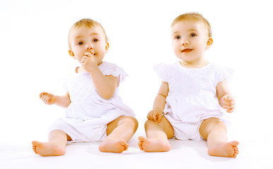 Two cute baby twins