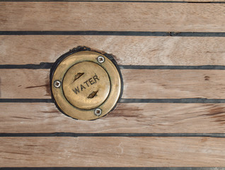 bronze cap in teak deck